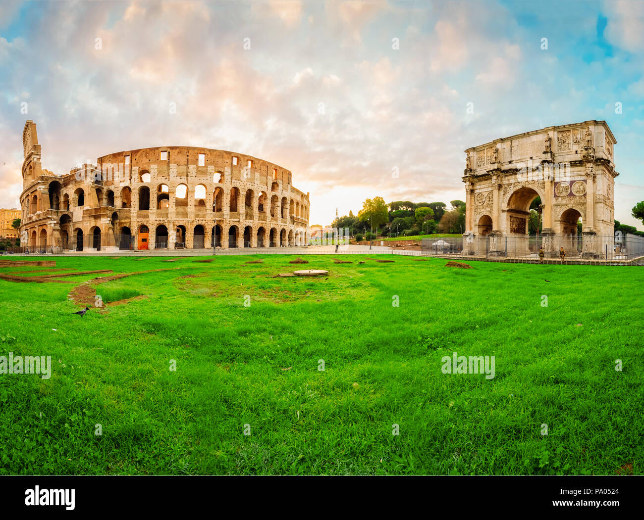 ruins of antique Colosseum and Arch of Constantine in sunise lights, Rome Italy, toned - Stock Image