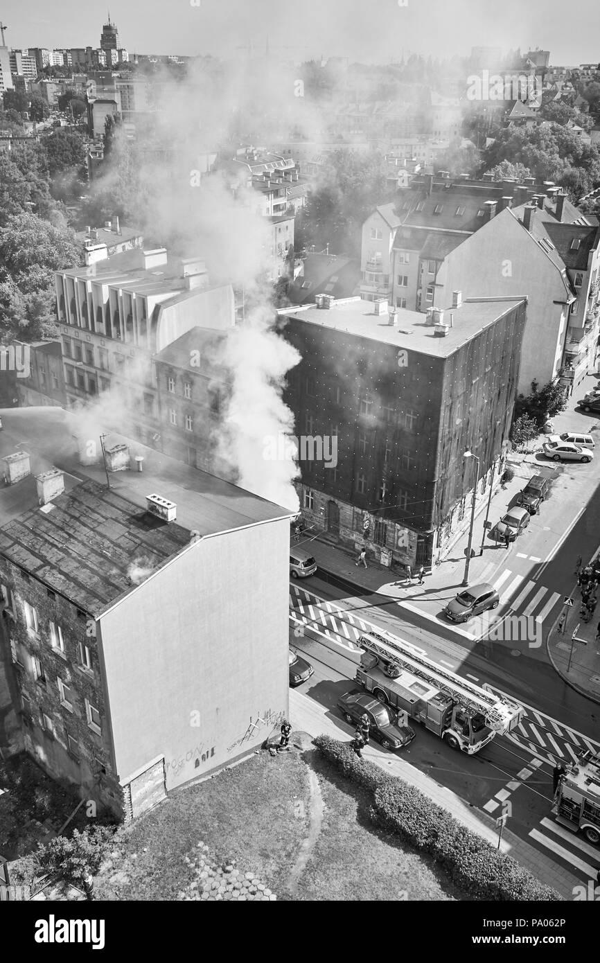 Szczecin, Poland - July 19, 2018: Fire brigade extinguish residential building fire at Niemierzynska Street. - Stock Image