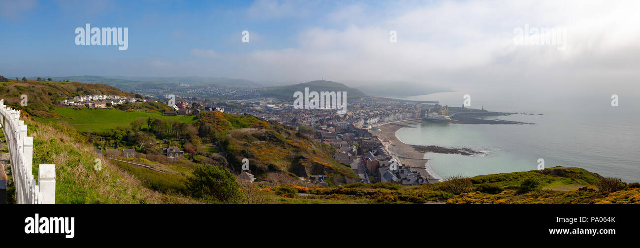 Panoramic image of Aberystwyth, Cardigan, Wales, UK, taken from Parc Natur Penglais, with sunshine, blue sky and sea mist - Stock Image