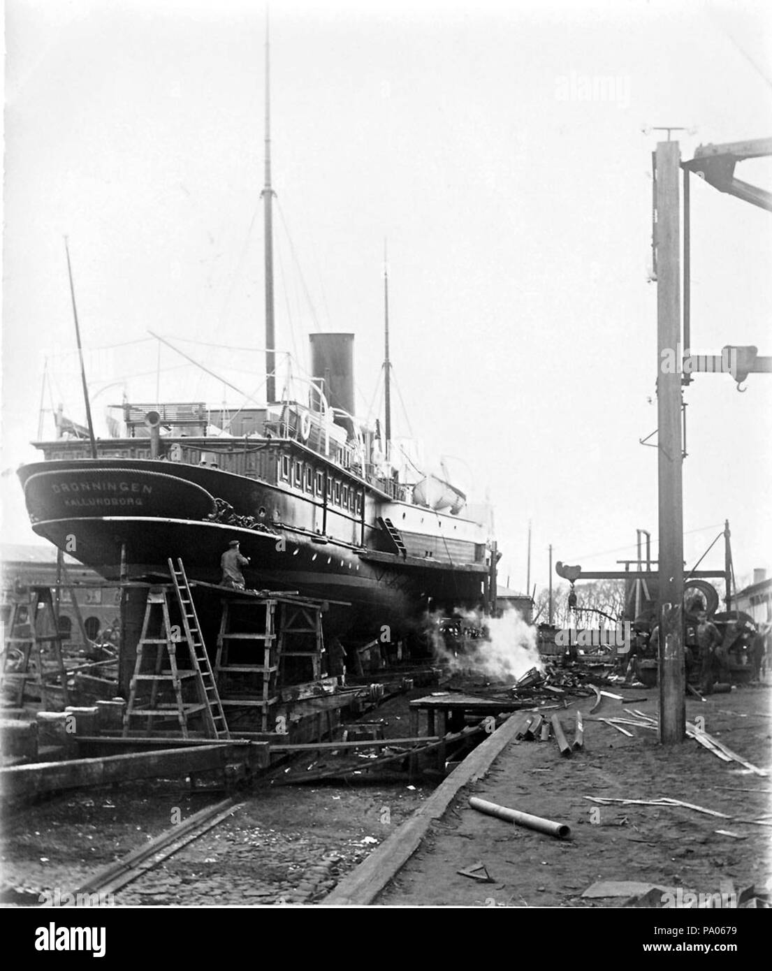 . The paddle steamer Dronningen at Elsinore Shipyard. The ship became Danish in 1888 and was wrecked in 1916. Photo property of Uffe Mortensen. circa 1900 592 Dronningen at Elsinore Shipyard - Stock Image