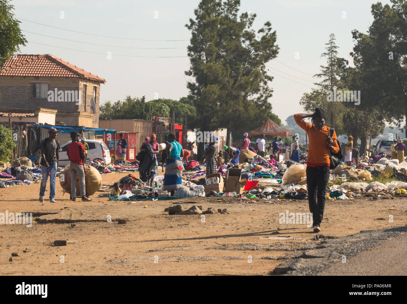 African street market and traders selling and swapping used and new clothing with a crowd of people outskirts of Johannesburg Gauteng South Africa - Stock Image