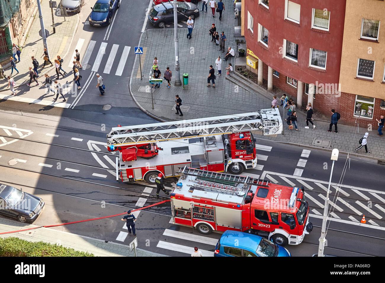 Szczecin, Poland - July 19, 2018: Fire brigade prepares to extinguish residential building fire at Niemierzynska Street. - Stock Image