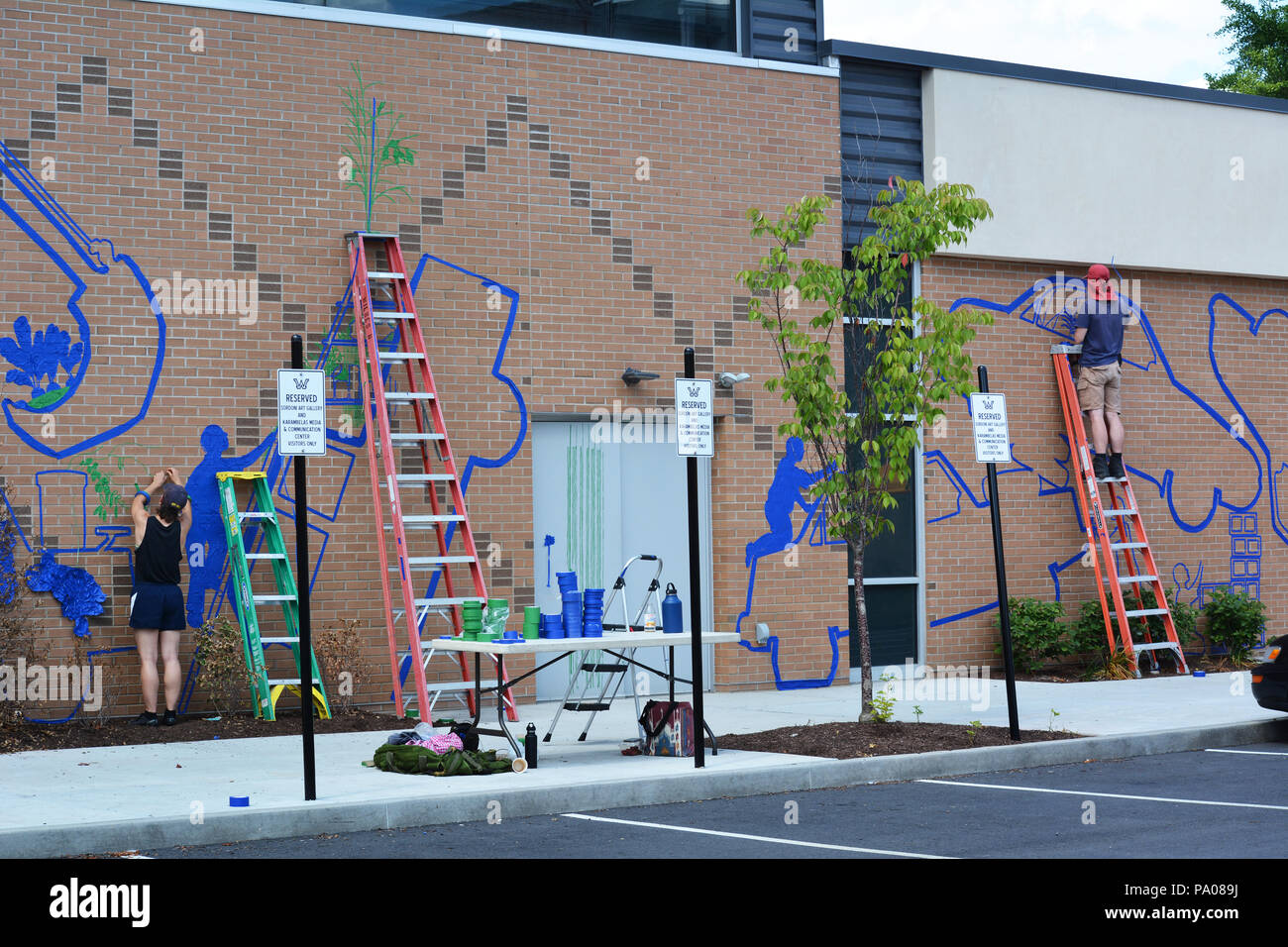 The Tape Art Crew based out of Providence, Rhode Island, with student help,working on a mural all week at The Sordoni Gallery, Wilkes University Stock Photo