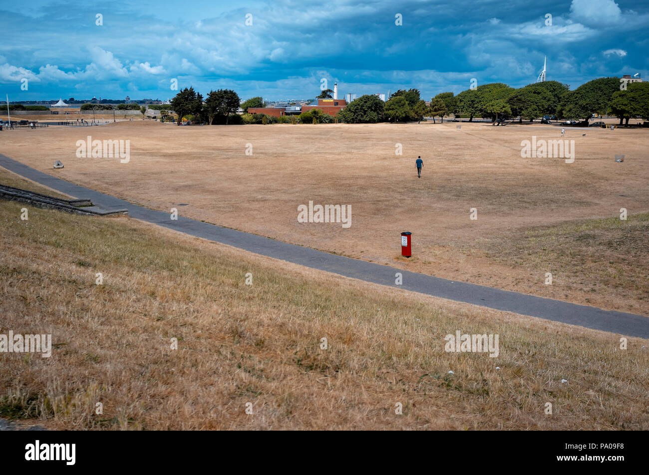 Dry brown grass field on Southsea Common public park due to the extreme hot weather this year. Stock Photo