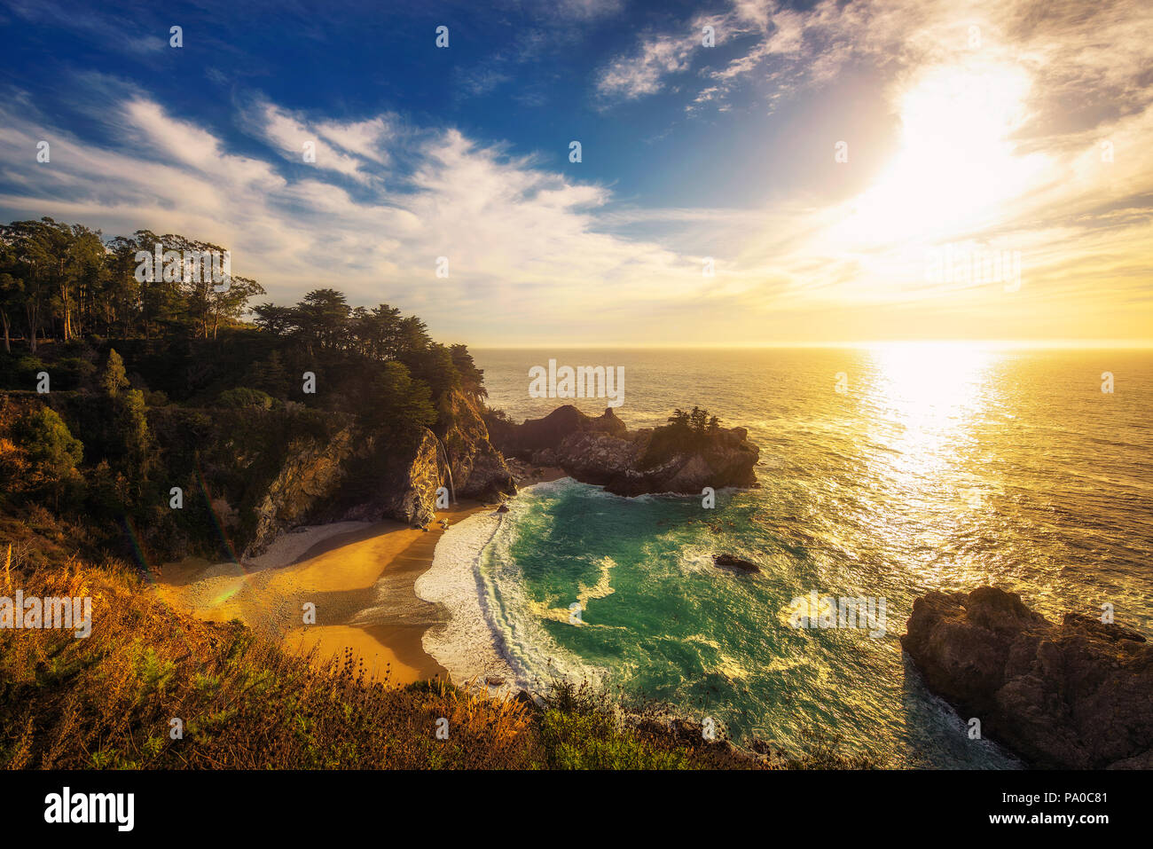 Sunset over McWay Falls on Pacific Coast Highway in California - Stock Image
