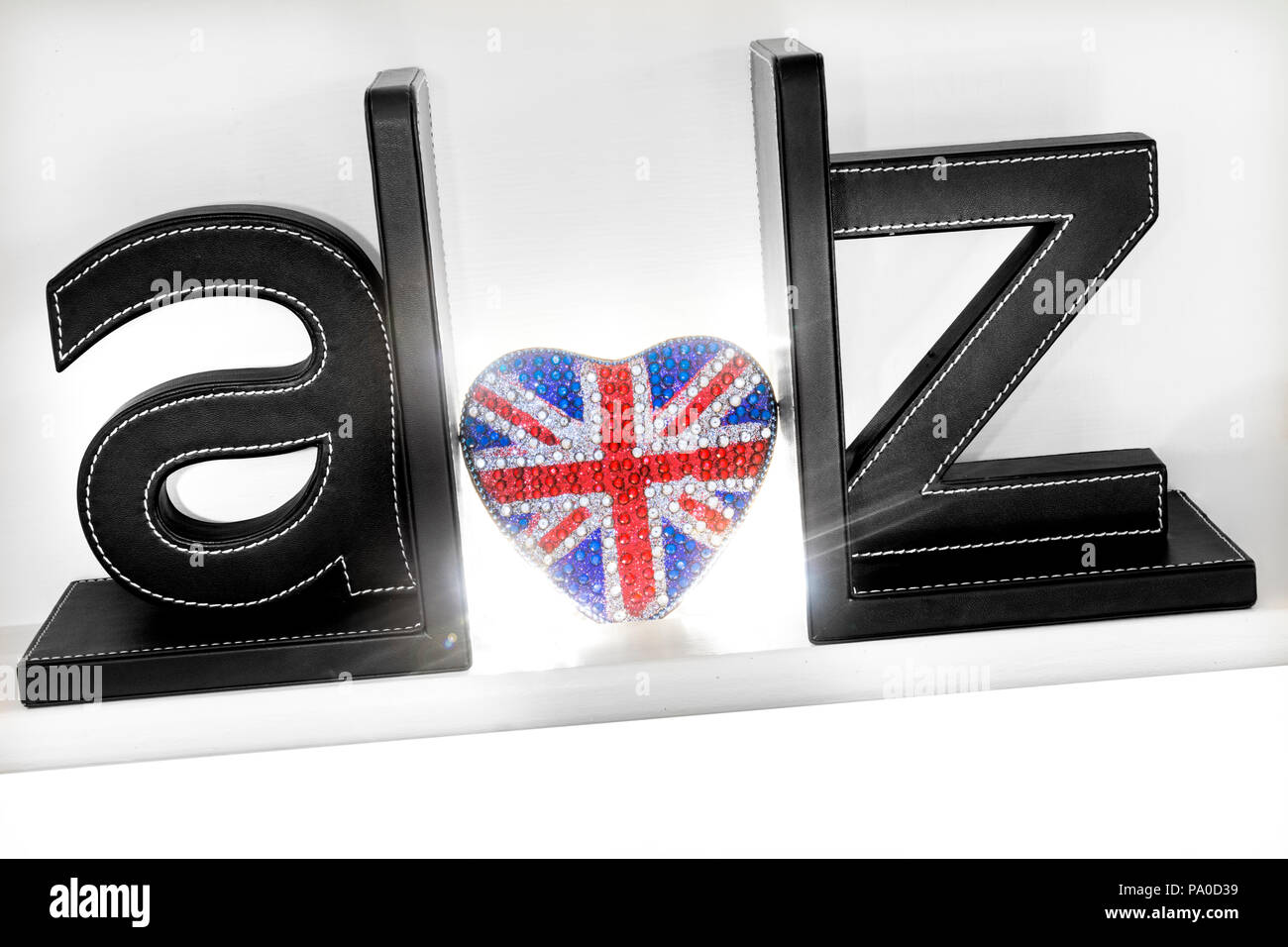 Concept A-Z three dimensional letters with sparkling heart shape Union Jack Flag motif shining out Love UK Travel Brexit Guide A to Z Britain Union - Stock Image