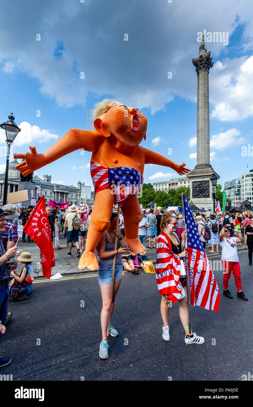 An Anti Trump Protestor Holding An Effigy Of President Trump During A Protest, Trafalgar Square, London, England - Stock Image