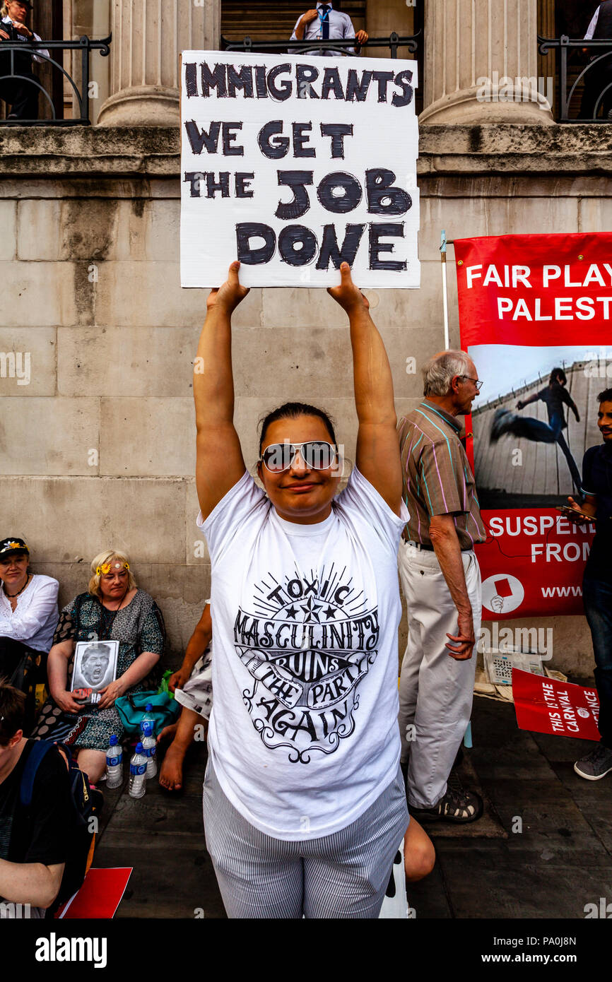 An Woman Holds Up A Pro Immigrant Sign During An Anti Trump Protest, Trafalgar Square, London, England - Stock Image