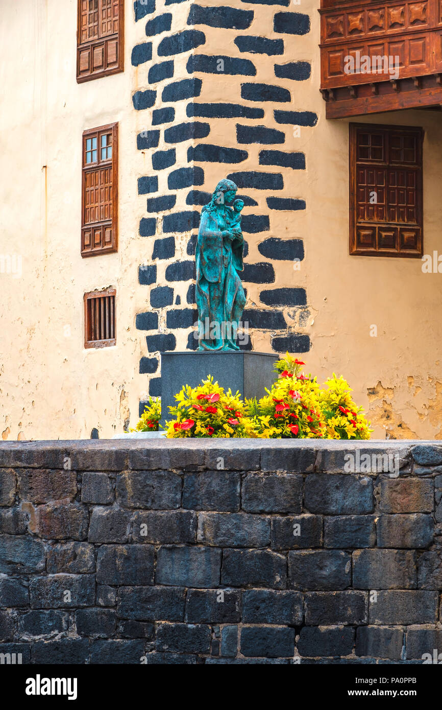 The Queen of the Sea sculpture was made in bronze and stands where the old crane was located behind the Casa de las Real Aduana, in the middle of the  - Stock Image