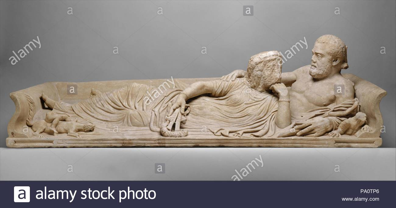 Marble sarcophagus lid with reclining couple, Imperial, Severan, ca. A.D. 220, Roman, Marble, length 91in. (231.1cm), Stone Sculpture, The couple are shown as semidivine personifications of water and earth. Like Hellenistic and Roman images of river gods, the bare-chested man holds a long reed, and a lizard-like creature crouches beside him. - Stock Image