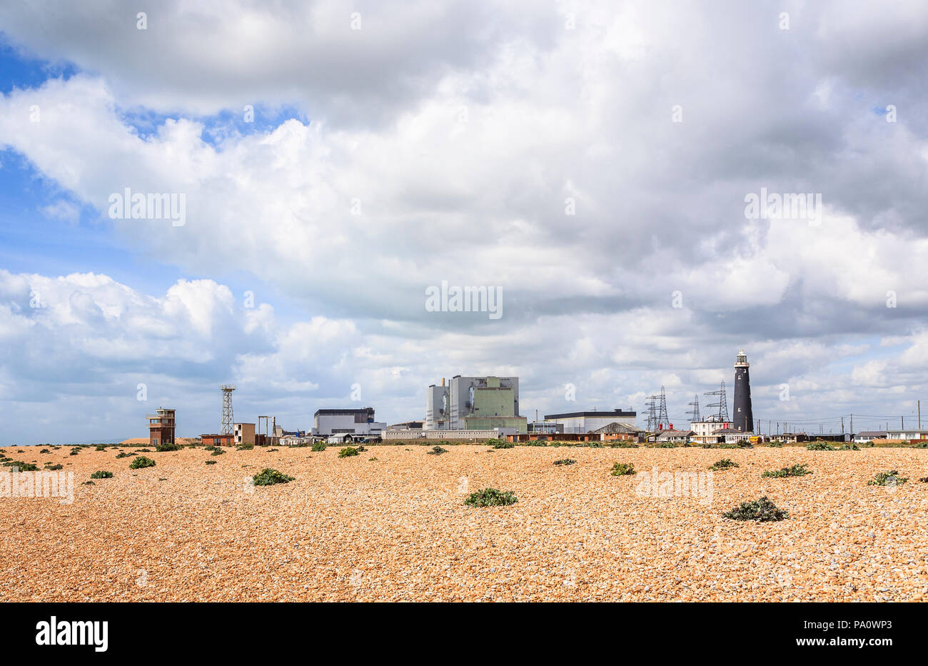 Dungeness B Nuclear Power Station and lighthouse at Dungeness, Lydd, Shepway district, Kent behind the gravel beach - Stock Image