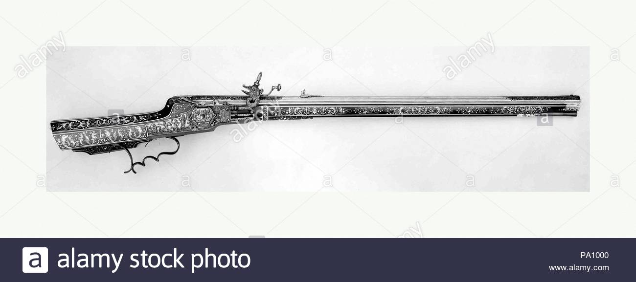 Wheellock Rifle, dated 1668, Munich and Augsburg, German, Munich and Augsburg, Steel, gold, wood (ebony), staghorn, bone, L. 30 9/16 in. (77.6 cm); L. of barrel 30 9/16 in. (77.6 cm); Cal. .55 in. (13.9 mm); Wt. 7 lb. 14 oz. (3572 g) , Firearms-Guns-Wheellock, The buttplate is inlaid with a griffin bearing a sword (the coat of arms of the Spät family), suggesting that this rifle was made for personal use by Caspar Spät or another family member. - Stock Image