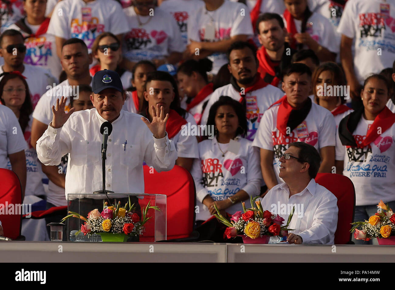 Managua, Nicaragua. 19th July, 2018. Nicaragua's President Daniel Ortega (c) speaks during an event with thousand of sandinistas at the Plaza de la Fe, in Managua, Nicaragua, on 19 July 2018. Ortega called the bishops of the Nicaraguan Bishops' Conference 'coup leaders' and said they were accomplices of internal and external forces to try to overthrow him. Credit: EFE News Agency/Alamy Live News - Stock Image
