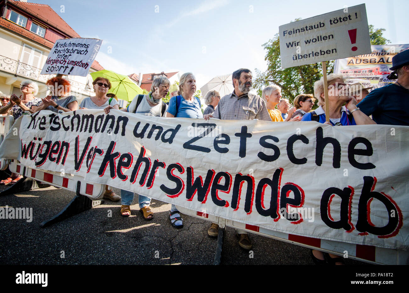 Stuttgart, Germany. 20th July, 2018. Members of the initiative «Traffic Change Now!» protesting before the State Ministry of the state of Baden-Wuerttemberg. The initiative is protesting against the 'Strategic Dialogue of the Automotive Industry BW' which is taking place at the same time in Stuttgart. Credit: Christoph Schmidt/dpa/Alamy Live News - Stock Image