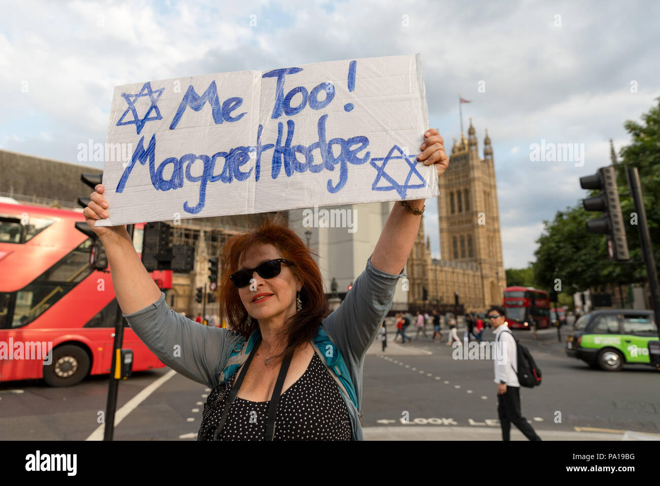 London, UK. 19th July 2018. The campaign group, Campaign Against Antisemitism, Jewish community groups and their supporters stage a protest in Parliament Square against the Labour Party anti-semitism code following the party's announcement that it will take action against Dame Margaret Hodge MP for calling Jeremy Corbyn an 'antisemite'. Credit: Vickie Flores/Alamy Live News - Stock Image