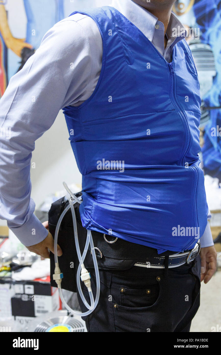 An Exhibitor Wears An Air Conditioned Clothing During The 4th Heat