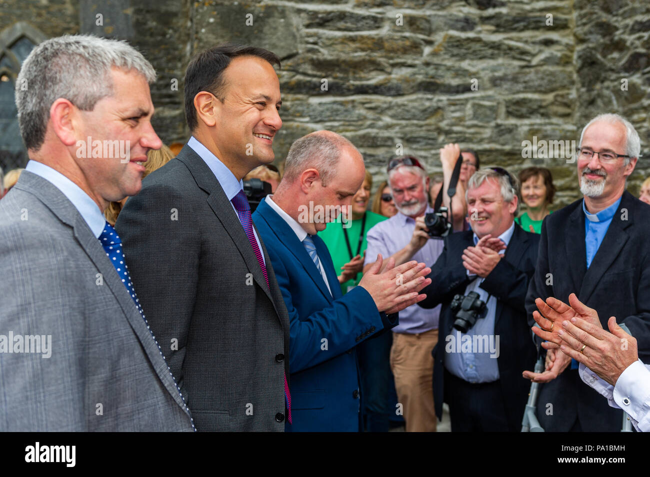 Dunmanway, West Cork, Ireland. 20th July, 2018. Taoiseach Leo Varadkar visited Dunmanway today to see the birthplace and final resting place of Sam Maguire. He also visited the Sam Maguire Bells in St. Mary's Church. Rev Cliff Jeffers, Rector of Fanlobbus Union, welcomed the Taoiseach to St. Mary's Church. Credit: Andy Gibson/Alamy Live News. - Stock Image