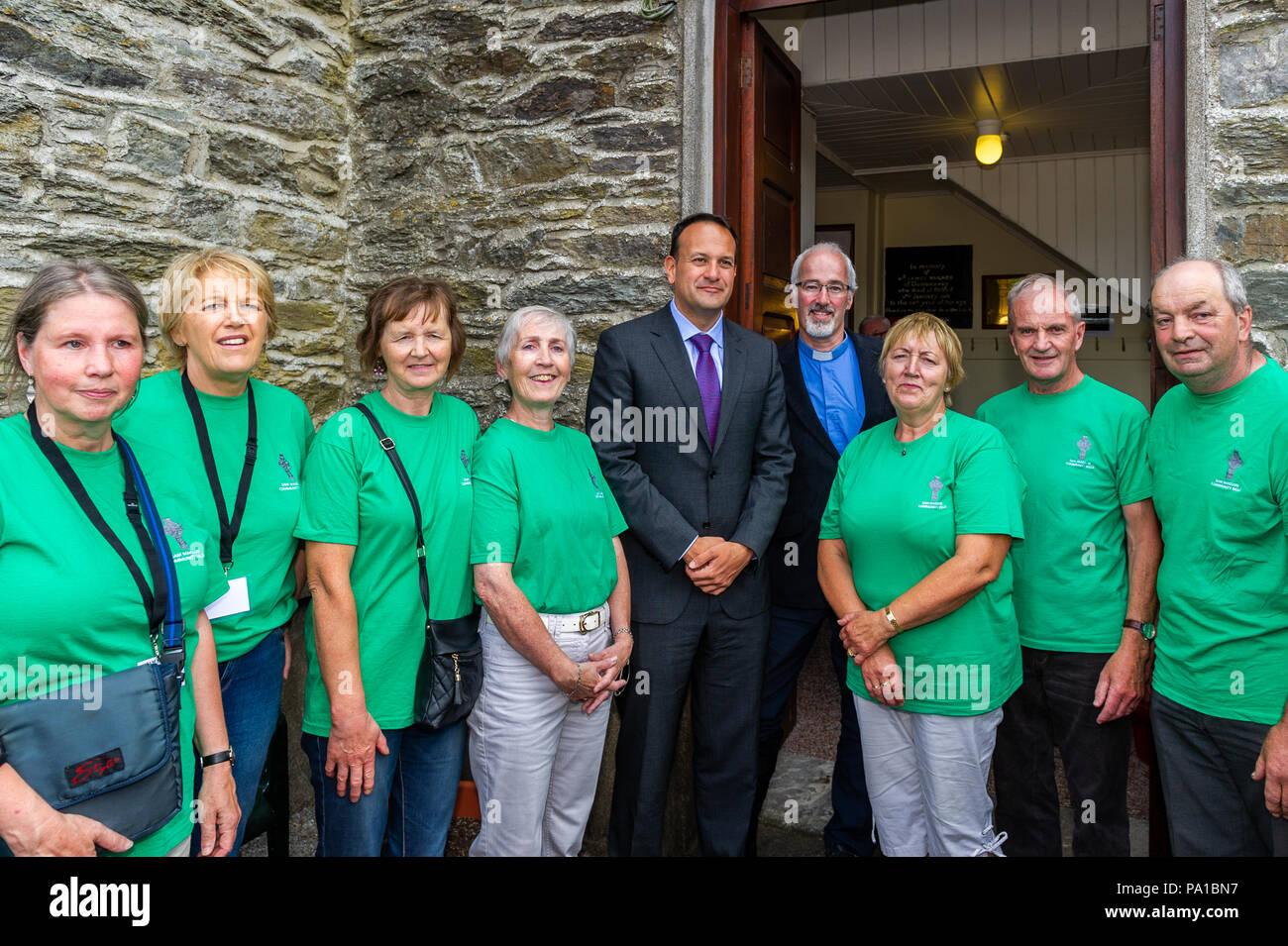 Dunmanway, West Cork, Ireland. 20th July, 2018. Taoiseach Leo Varadkar visited Dunmanway today to see the birthplace and final resting place of Sam Maguire. He also visited the Sam Maguire Bells in St. Mary's Church. Rev Cliff Jeffers, Rector of Fanlobbus Union, and the Sam Maguire Community Bells Team posed for a picture with the Taoiseach. Credit: Andy Gibson/Alamy Live News. - Stock Image