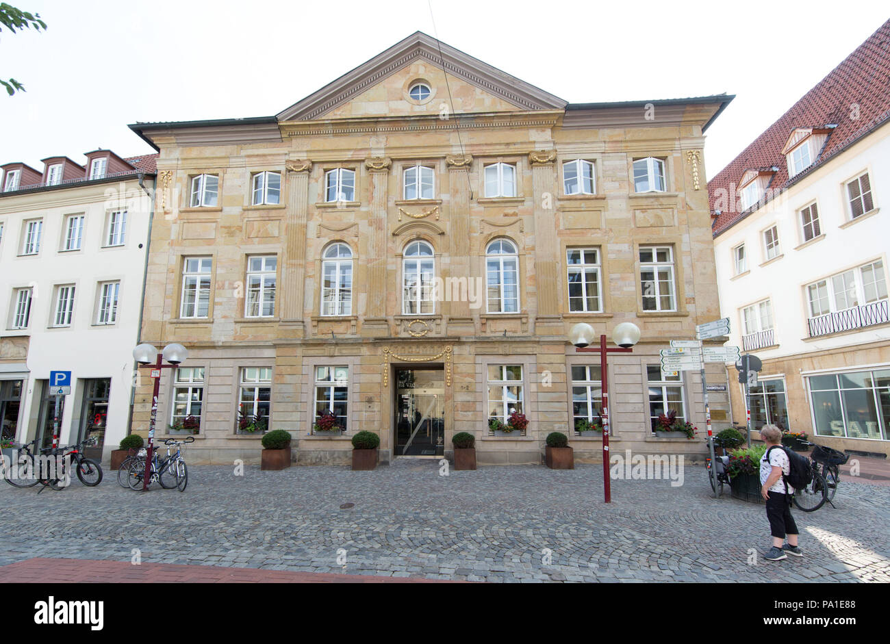 """Osanbrueck, Germany. 20th July, 2018. Plaques and awards are missing on the facade of the restaurant """"La Vie"""". The gourmet restaurant which was awarded in 2011 with three Michelin Stars has to shut down. Reservations and long planned parties are cancelled. Lower Saxony looses one of the best restaurants in the world. Credit: Friso Gentsch/dpa/Alamy Live News Stock Photo"""