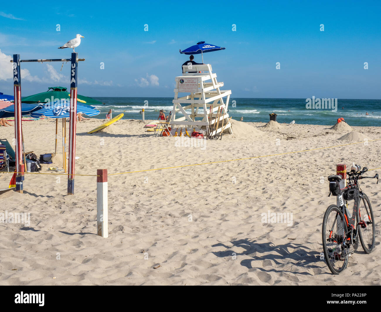 Day at the beach with lifeguard on duty, The Hamptons, New York, USA. - Stock Image