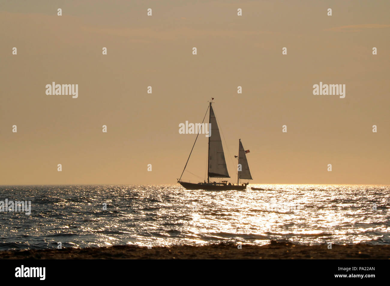 A sail boat off Sandy Point in Block Island, Rhode Island at sunset.in summer. - Stock Image