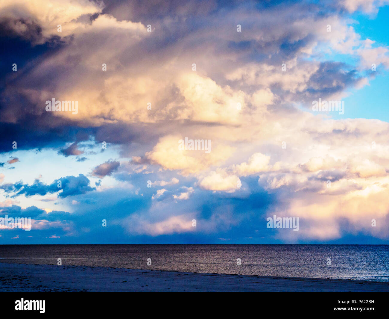 Light breaking through clouds at ocean, The Hamptons, New York, USA. - Stock Image