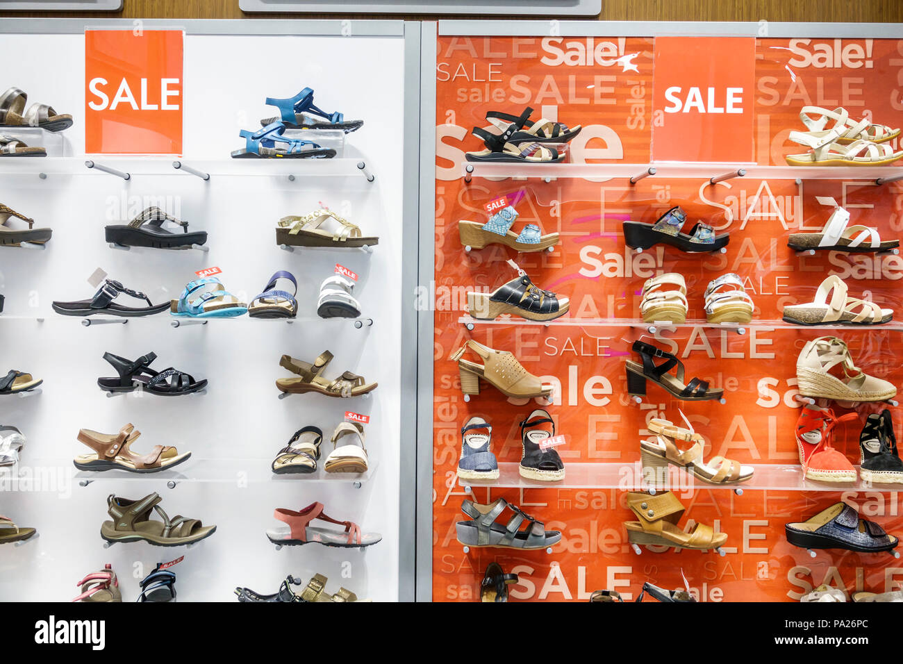 Orlando Florida The Mall at Millenia shopping The Walking Store retail chain comfort shoes display women's sandals sale interior - Stock Image
