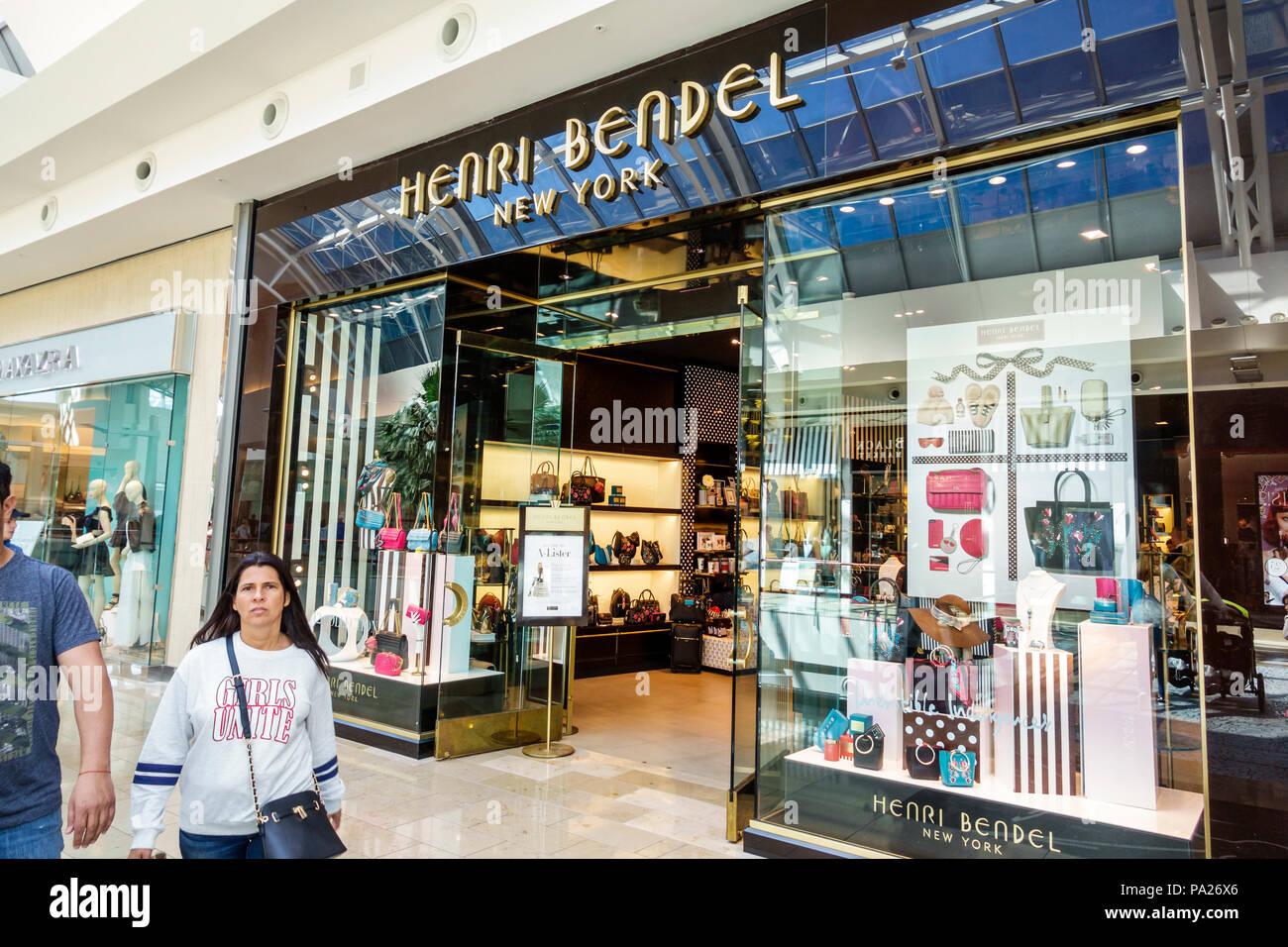 Orlando Florida The Mall at Millenia shopping Henri Bendel designer boutique handbags upscale women's specialty store entrance window display woman wa - Stock Image