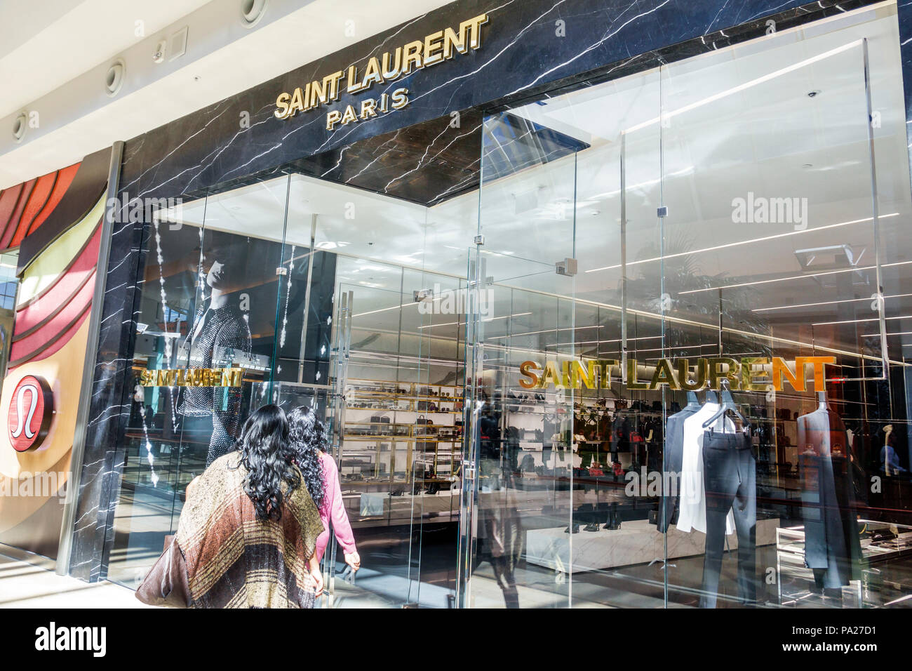Orlando Florida The Mall at Millenia shopping Saint Laurent French designer upscale boutique store entrance window display interior - Stock Image