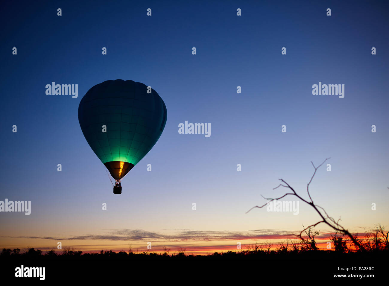 19th July 2018, two hot air balloons attempting a long distance flight, launch from a field near Merbein in North West Victoria. The balloon pictured  - Stock Image