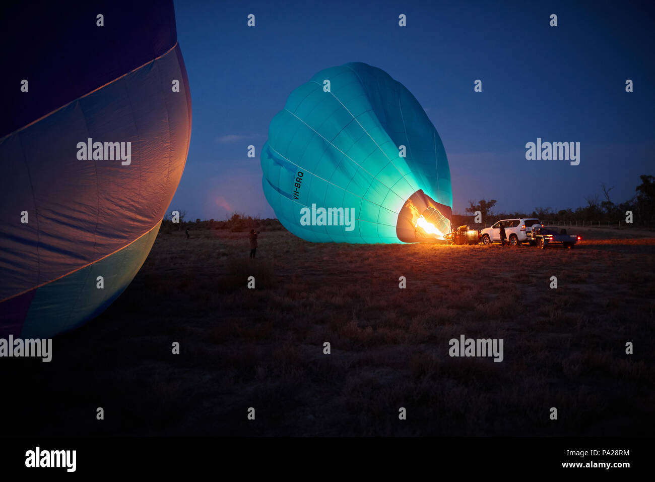 19th July 2018, two hot air balloons attempting a long distance flight, launch from a field near Merbein in North West Victoria, Australia. - Stock Image