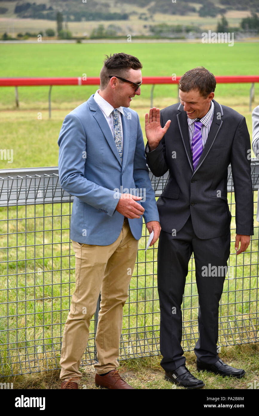two men congratulating one another in the adult male fashion parade at the 2018 glen innes horse races at the racetrack - Stock Image