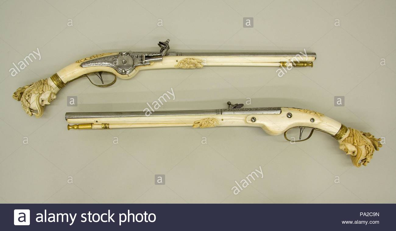 Pair of Wheellock Pistols, ca. 1655–65, Maastricht, Dutch, Maastricht, Steel, brass, gold, ivory, L. of 14.252a: 22 1/2 in. (57.2 cm); L. of 14.252b: 22 3/4 in. (57.8 cm); L. of each barrel 14 7/8 in. (37.8 cm); Cal. of each barrel .53 in. (13.5 mm); Wt. of each 2 lb. 3 oz. (992 g), Firearms, Very few Dutch ivory stocked pistols have wheellocks; the great majority are equipped with flintlocks. This pair also appears to be among the earliest known wheellock examples. - Stock Image