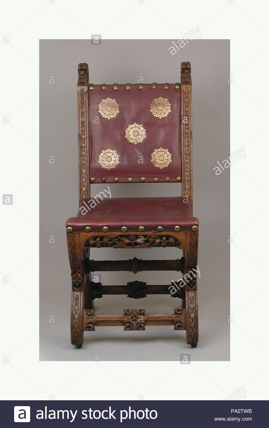 Side chair, ca. 1847, British, Carved oak, gold-stamped leather; metal casters, Overall (confirmed): 39 1/2 × 17 3/4 × 22 in. (100.3 × 45.1 × 55.9 cm), Woodwork-Furniture, John Webb (British, 1799–1880), This chair comes from the Palace of Westminster which was rebuilt after a devastating fire in 1834 by Charles Barry. Having won the competition to design the building in a Gothic style, Barry was assisted by A. - Stock Image