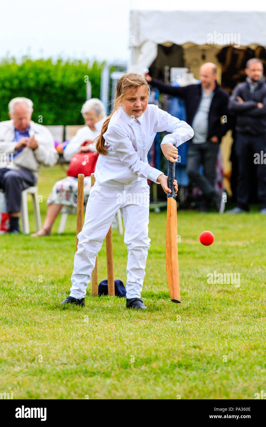 Young girl child 12-13 years batting with cricket bat while dressed up in Victorian costume during cricket match. Broadstairs Dickens week festival  sc 1 st  Alamy & Young girl child 12-13 years batting with cricket bat while ...