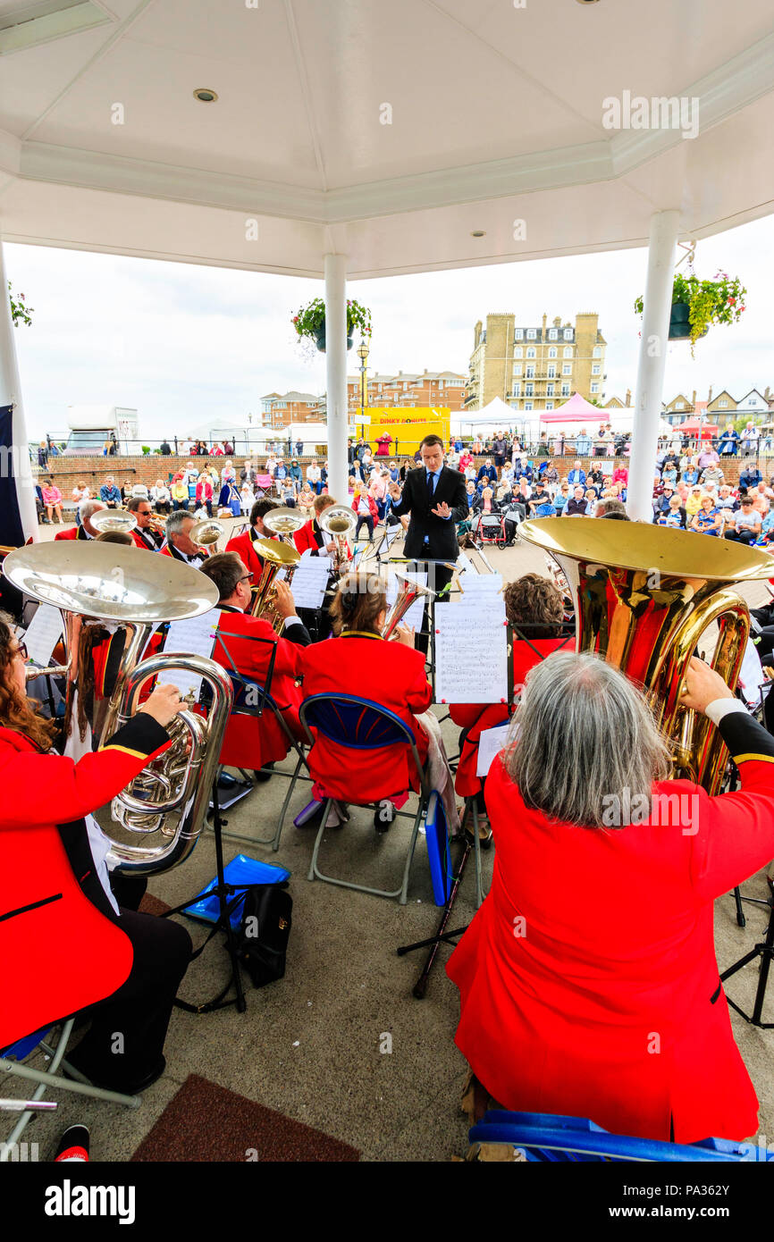 Salvation Army band performing on summer's day at the bandstand on Broadstairs seafront. Over the shoulder view from back of orchestra. - Stock Image