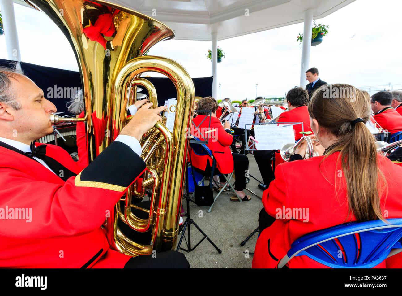 Salvation Army band performing on summer's day at the bandstand on Broadstairs seafront. Over the shoulder view from back of orchestra. Stock Photo