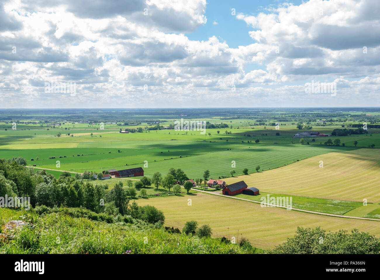 Rural country landscape view with a farm - Stock Image