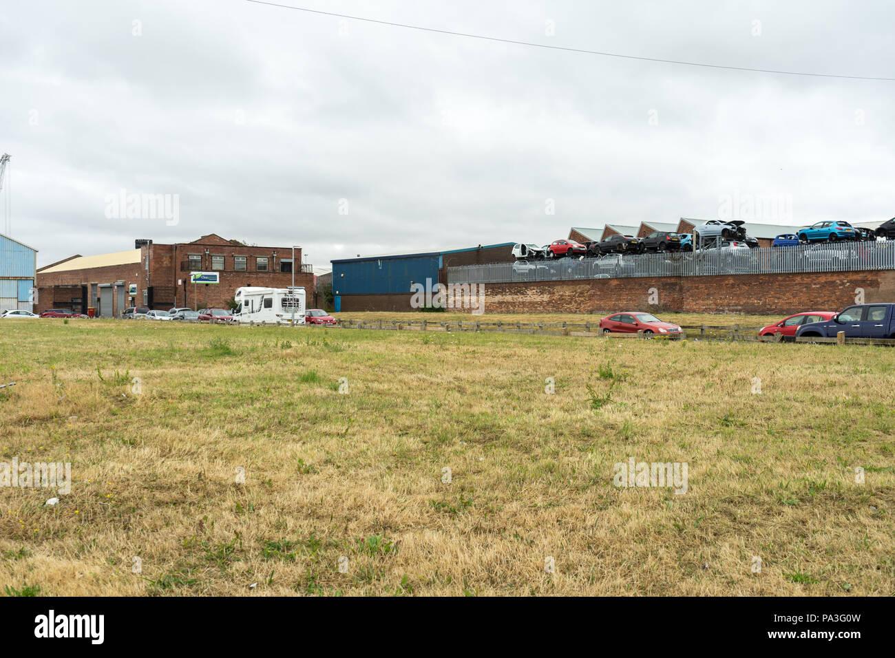 Industrial area in Birkenhead, Wirral, showing a car scrap yard - Stock Image