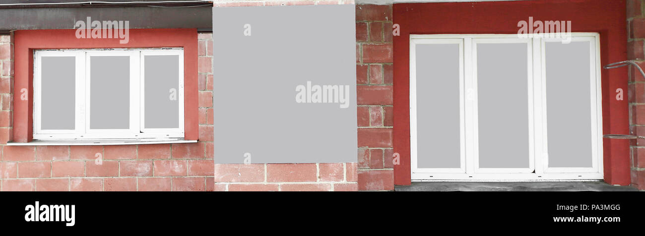 panoramic photo.an empty poster between the Windows of the house - Stock Image