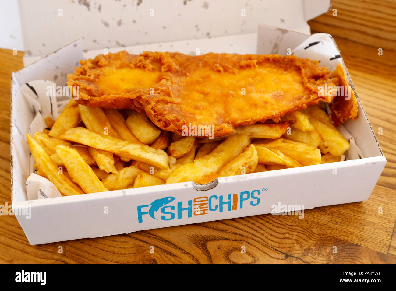 Fish and chips served at Tynemouth in England. The dish is traditional British meal. - Stock Image