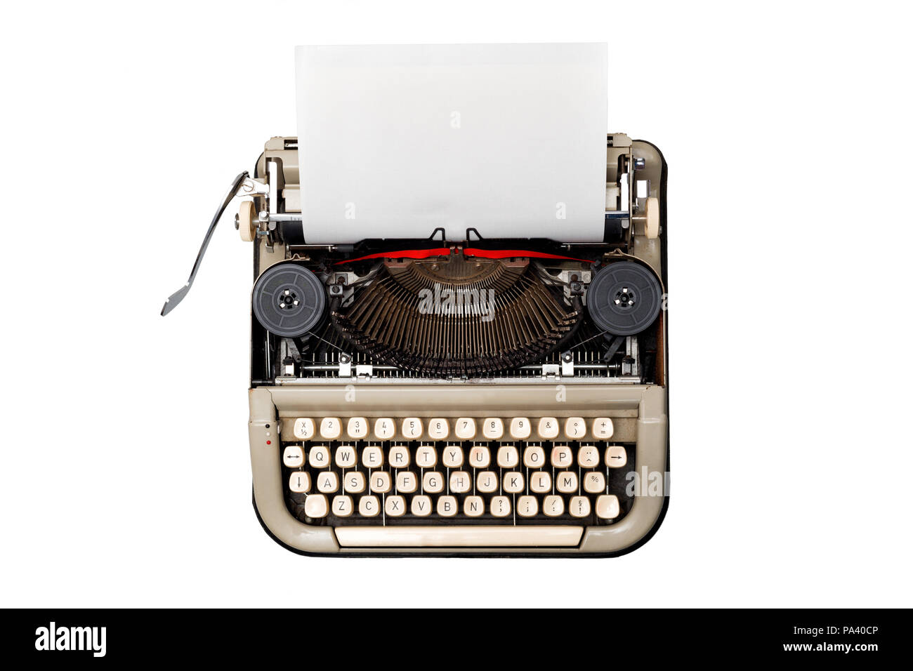 vintage typewriter isolated on white background with blank textured sheet loaded ready to type - Stock Image