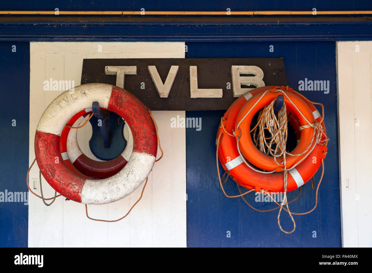 Flotation aids at Tynemouth in England. The devices hand on the exterior of the Tynemouth Volunteer Lifeboat Brigade watch house. Stock Photo
