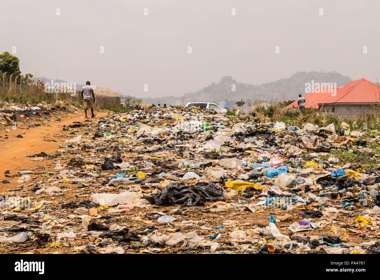 A pile of rubber bags wasteland causing pollution in the city - Stock Image