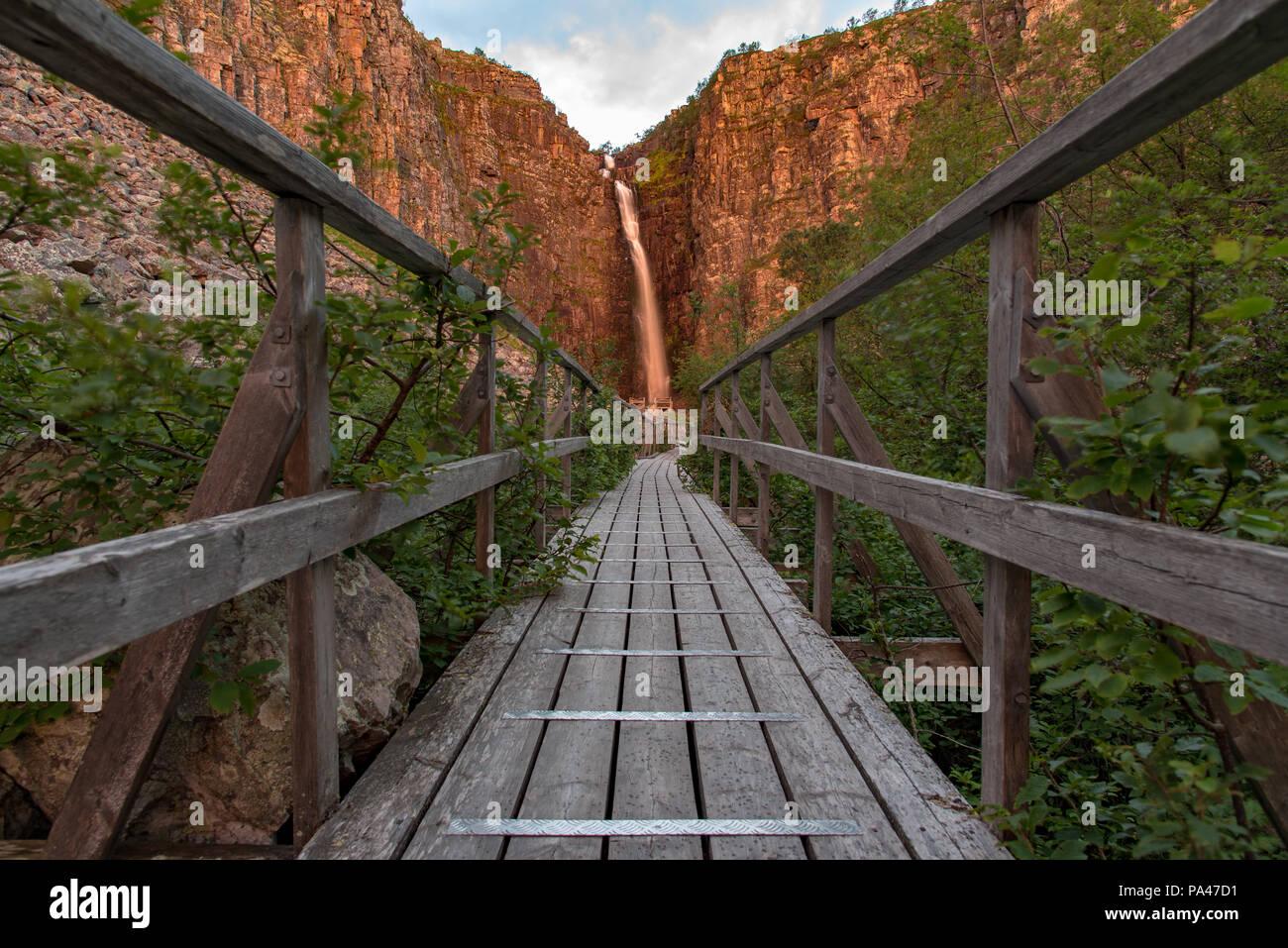 sunrise over a footbridge in fulufjallet national park dalarna Sweden Stock Photo