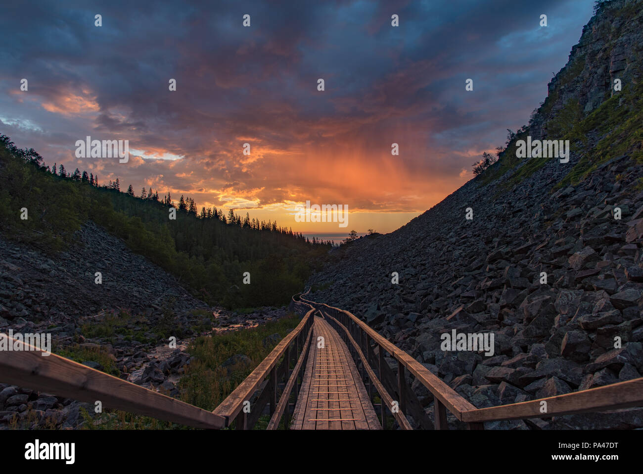 sunrise over a footbridge in fulufjallet national park dalarna Sweden - Stock Image