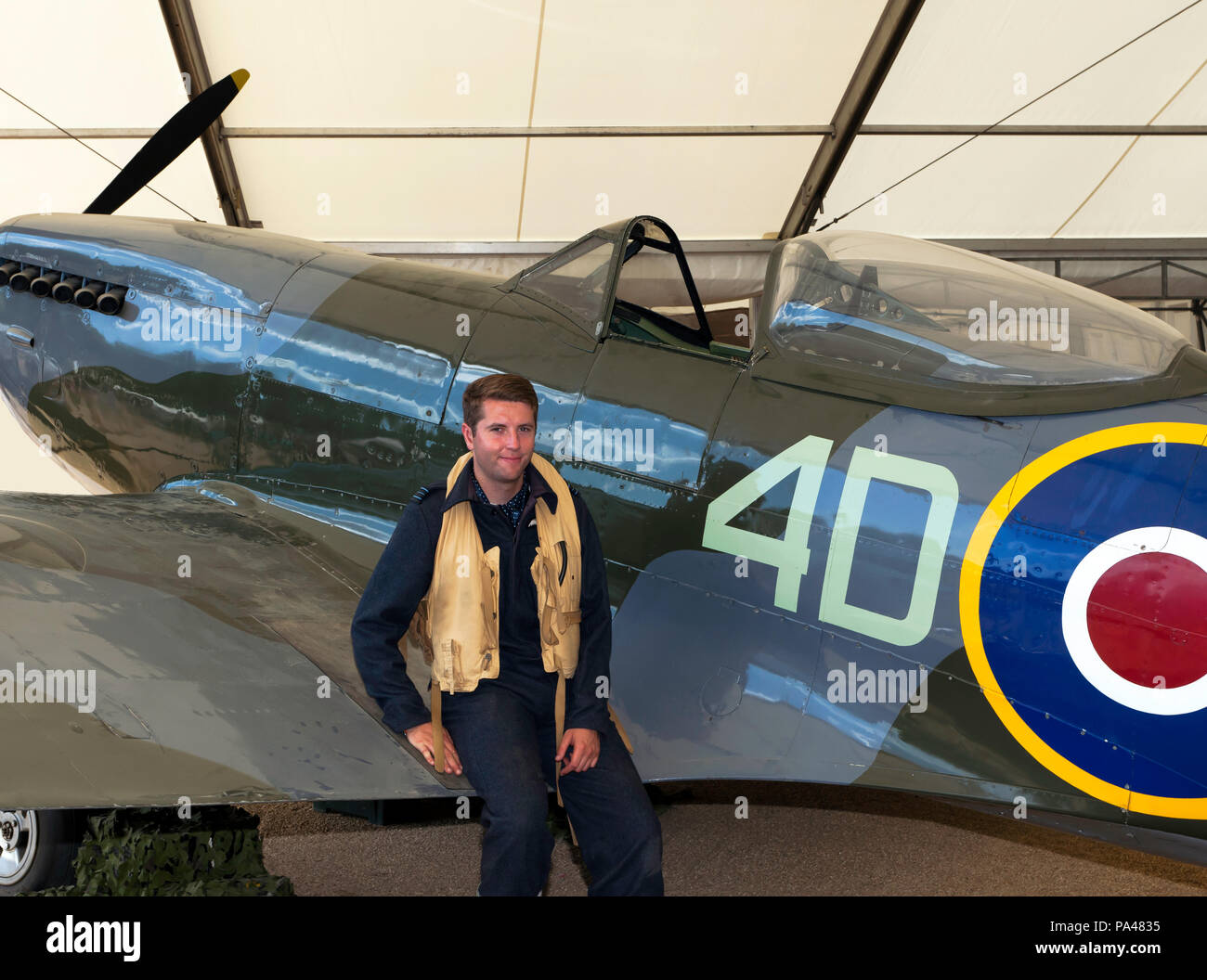 Man  in period pilots uniform, poses  by a  Supermarine Spitfire Mk XVI, part of the RAF Centennial Celebrations at  Horse Guards  Parade, London. - Stock Image