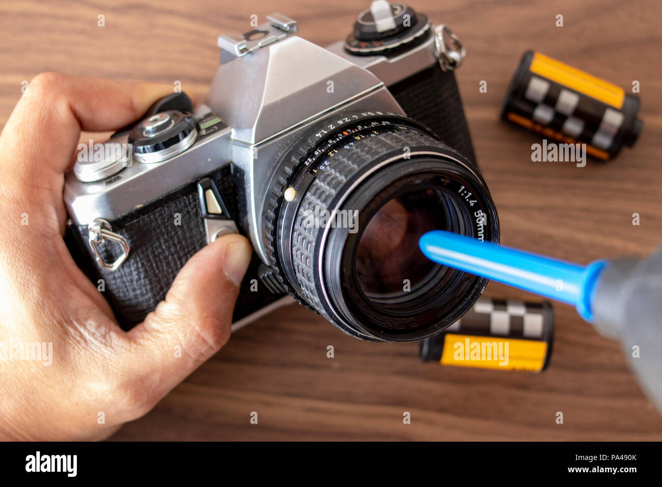 Performing a maintenance on a camera with tools - Stock Image