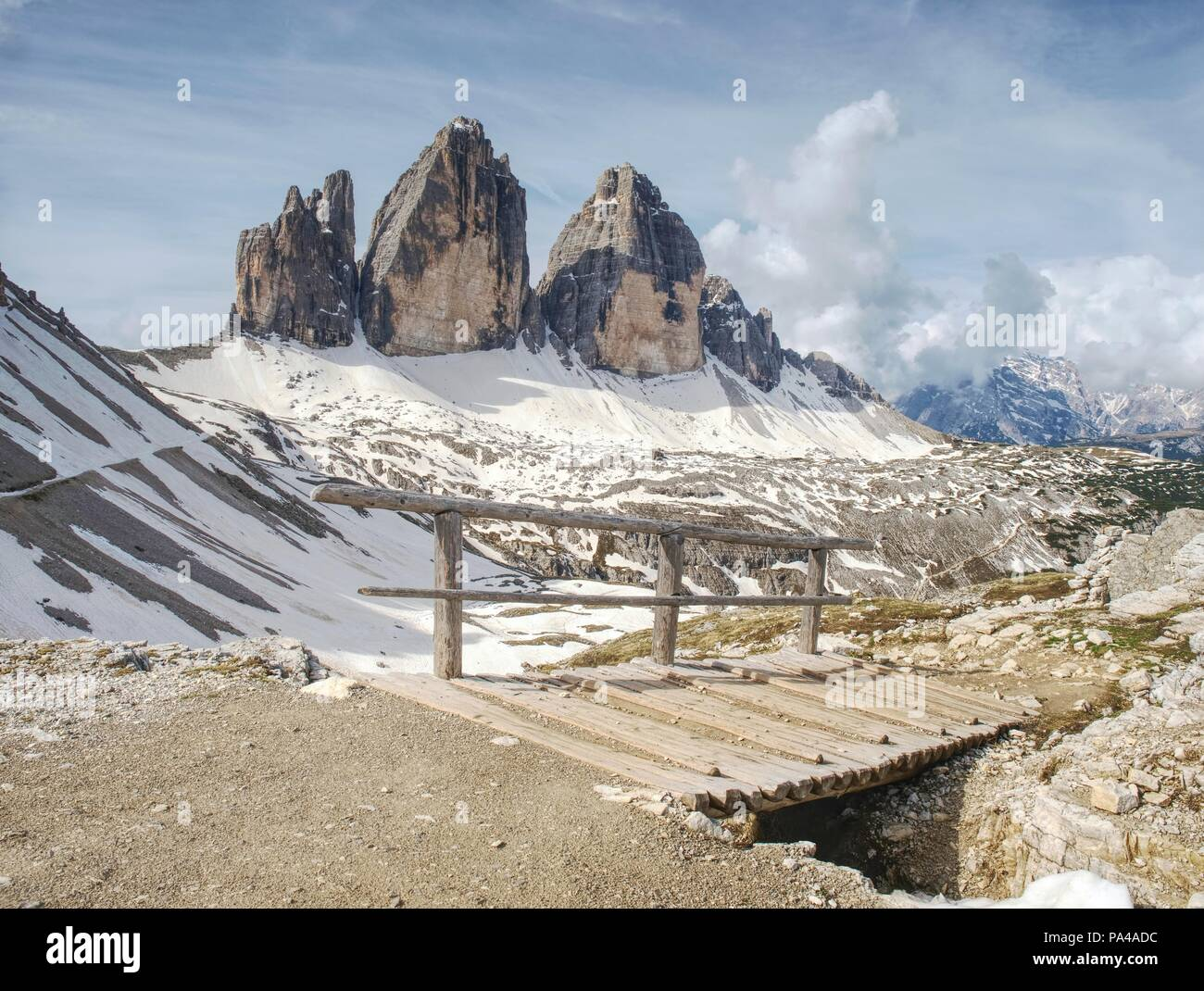 Wooden bridge and wooden handrail at difficulty part of popular trek around Tre Cime di Lavaredo ' Drei Zinnen ' in Dolomite Alps - Italy. - Stock Image