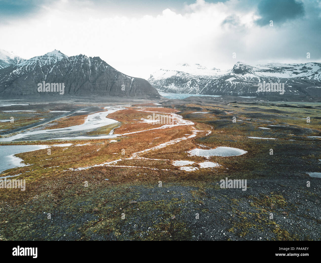 Vatnajokull glacier aerial drone image with clouds and blue sky. Dramatic winter scene of Vatnajokull National Park, Iceland, Europe. Beauty of nature concept background. - Stock Image
